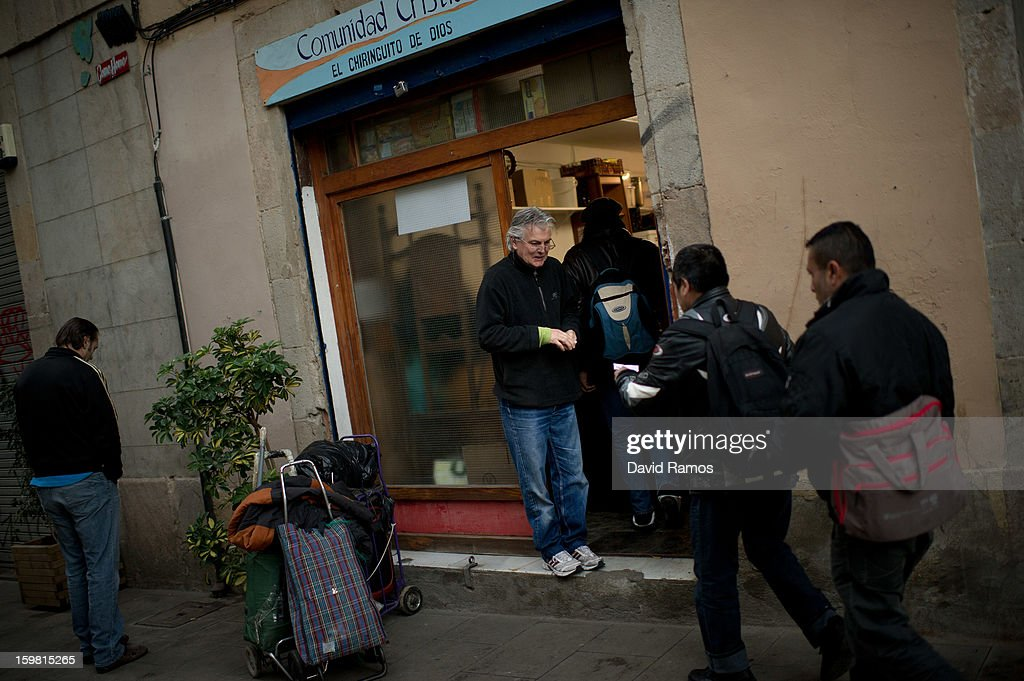 Wolfgang Striebinger of Germany, 60, welcomes needy people coming for breakfast at 'El Chiringuito de Dios' ('The Stall of God') on January 3, 2013 in Barcelona, Spain. The German pastor Wolfgang Striebinger has lived in Barcelona since 1991, originally employed to minister to youths during the Barcelona Olympic Games, he decided to stay and since 2000 has run 'El Chinguito de Dios' (The Stall of God). In his mission to support the homeless, Wolfgang and his volunteers offer a place for up to 200 people to come and have some food daily and also offering them assistance with grooming and clothes. Many of the volunteers are homeless and help out in return for meals and a bed. Wolfgang's ethos is to provide peace, calm and dignity to all those that need it amongst Barcelona's burgeoning homeless population. Due to the economic situation his doors are now also open to the long term unemployed and families with little or no income. According to the latest figures 21.8% of the Spanish populations are living below the poverty line.