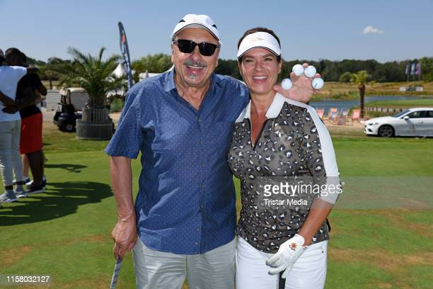 Wolfgang Stumph and Katarina Witt during the 12th GRK Golf Charity Masters on July 27, 2019 in Leipzig, Germany.
