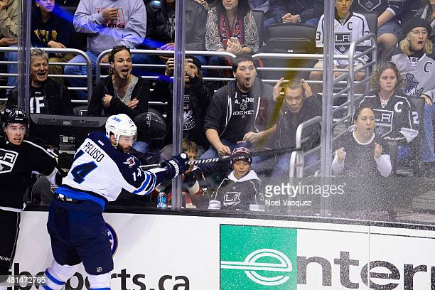 Wolfgang Van Halen and Eddie Van Halen attend a hockey game between the Winnipeg Jets and the Los Angeles Kings at Staples Center on March 29 2014 in...