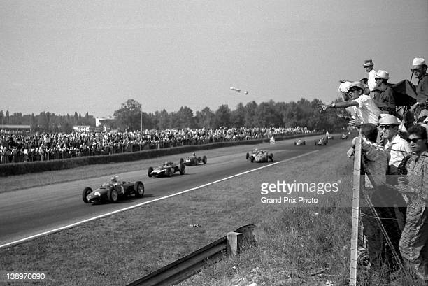 Wolfgang von Trips of Germany drives the Scuderia Ferrari Ferrari 156 Sharknose ahead of Jack Brabham in the Cooper Car Company Cooper T58 Climax V8...