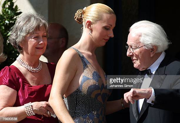 Wolfgang Wagner grandson of the German composer Richard Wagner and director of the Bayreuth Festival his wife Gudrun and his daughter Katharina...