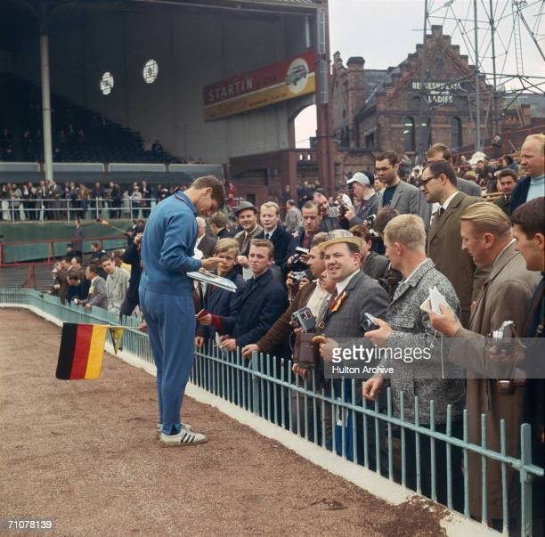 Wolfgang Weber signing autographs for German fans supporting their team at Villa Park during the group stages of the 1966 World Cup in England July...