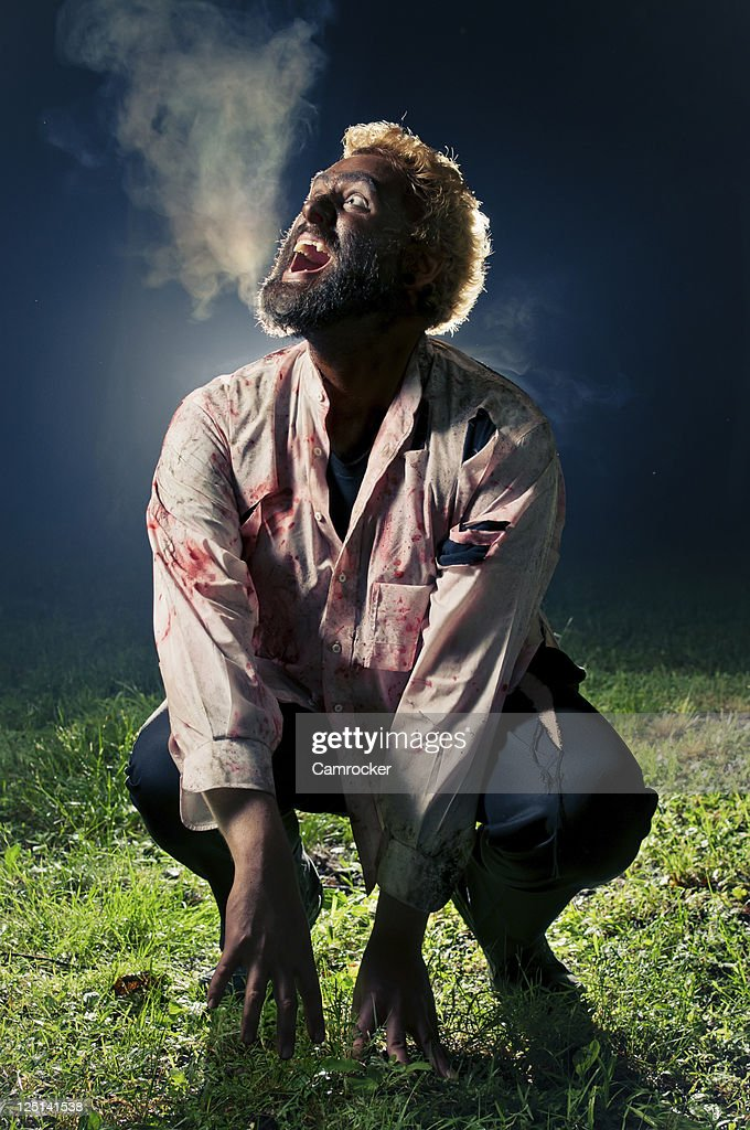 Wolfman Howling At The Moon : Stock Photo
