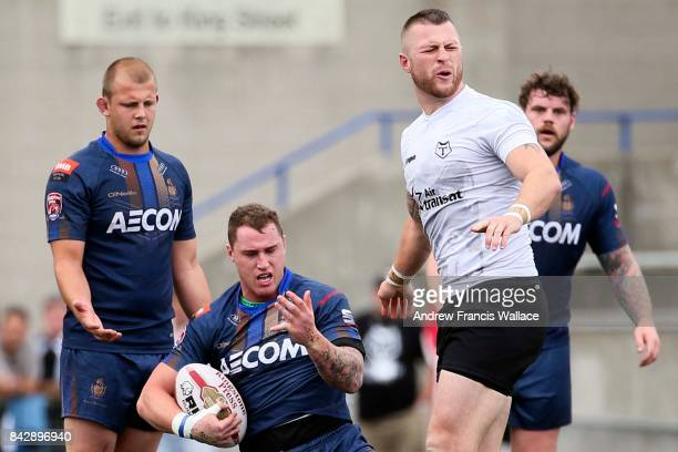 TORONTO ON SEPTEMBER 2 Wolfpack Prop Adam Sidlow reacts to Whitehaven Full Back Elliot Miller dislocated finger during first half Super 8 Rugby...