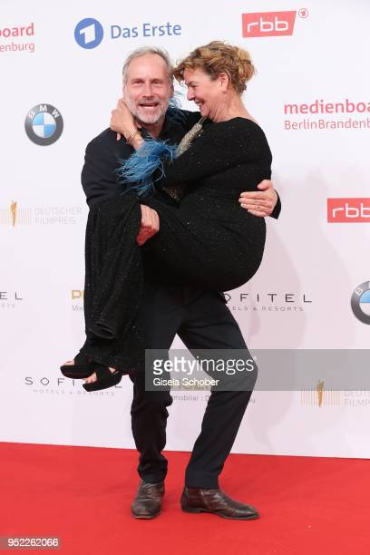 Wolfram Koch carries Margarita Broich during the Lola German Film Award red carpet at Messe Berlin on April 27 2018 in Berlin Germany