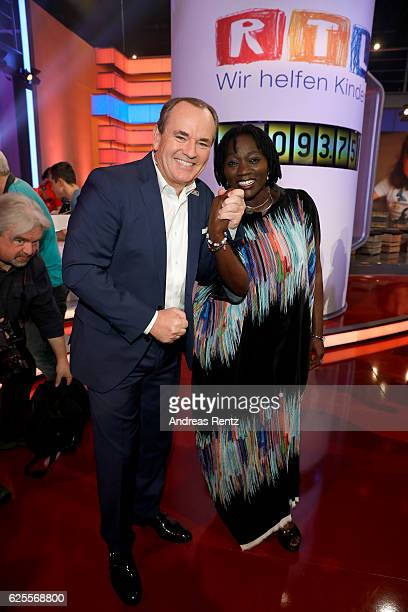 Wolfram Kons and Auma Obama are seen in the studio of the RTL Telethon TV show on November 24 2016 in Cologne Germany The telethon is held every year...