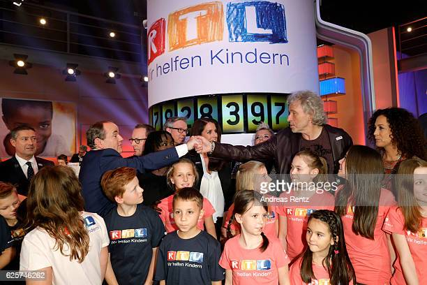 Wolfram Kons thanks Thomas Gottschalk during the RTL Telethon TV show on November 25, 2016 in Cologne, Germany. The telethon is held every year and...