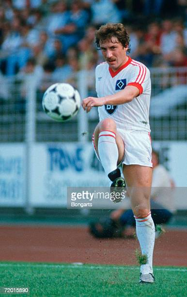 Wolfram Wuttke of Hamburg in action during the DFB German Cup match between Hamburger SV and Borussia Dortmund on August 28 1983 in Hamburg Germany