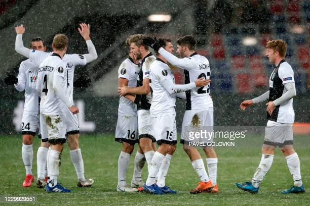 Wolfsberg's players celebrate after the UEFA Europa League football match between CSKA Moscow and Wolfsberg at Moscow's CSKA Arena on December 3,...