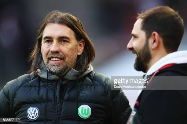 Wolfsburg Manager / Head Coach Martin Schmidt and FC Koeln Manager / Head Coach Stefan Ruthenbeck speak prior to the Bundesliga match between 1 FC...