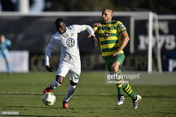 Wolfsburg midfielder Amara Conde protects the ball from Tampa Bay Rowdies midfielder Keith Savage during the first half of a Florida Cup soccer game...