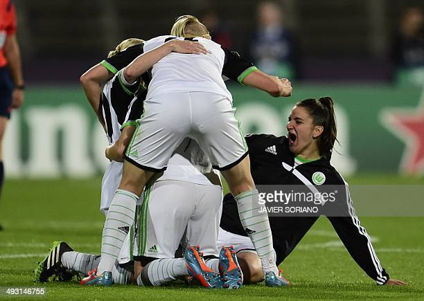 Wolfsburg players celebrate after winning the UEFA Women's Champions League final football match Tyreso FF vs Vfl Wolfsburg at Restelo stadium in...
