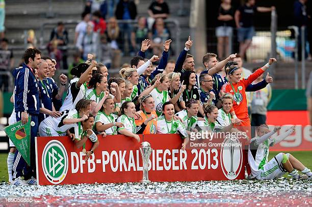 Wolfsburg players celebrate after winning the Women's DFB Cup Final between VfL Wolfsburg and 1 FFC Turbine Potsdam at Rhein Energie Stadion on May...