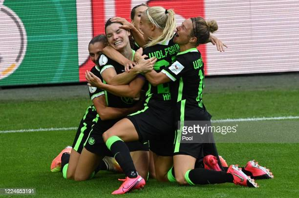 Wolfsburg players celebrate their third goal scored by Dominique Bloodworth during the Women's DFB Cup final between VfL Wolfsburg Women's and SGS...