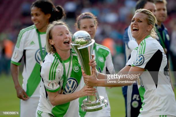 Wolfsburg players Conny Pohlers and Lena Goessling celebrate after winning the Women's DFB Cup Final between VfL Wolfsburg and 1 FFC Turbine Potsdam...