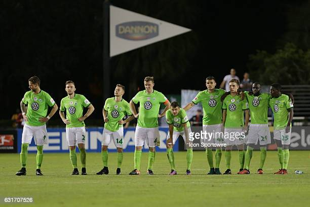 Wolfsburg players look on as their goalkeeper Alexander Brunst lines up to defend a Bahia penalty kick in a Florida Cup soccer match between VFL...