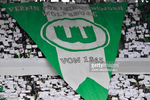 Wolfsburg supporters display a giant team insigna prior to the German First division Bundesliga football match between VfL Wolfsburg and SC Freiburg...