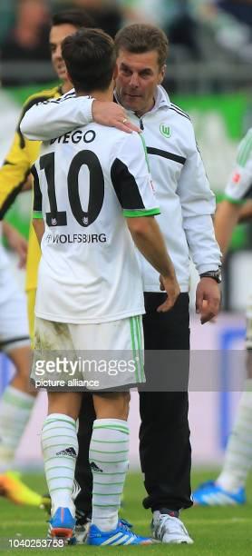 Wolfsburg'coach Dieter Hecking and Diego celebrate after the match between VfL Wolfsburg and TSG1890 Hoffenheim at Volkswagen-Arena in Wolfburg,...