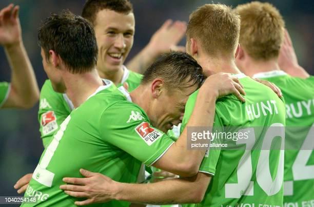 Wolfsburg's Aaron Hunt celebrates his 20 goal with teammate Ivica Olic during the German Bundesliga soccer match between VfL Wolfsburg and Hamburger...