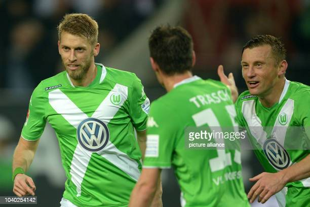 Wolfsburg's Aaron Hunt celebrates his 20 goal with teammates Christian Traesch and Ivica Olic during the German Bundesliga soccer match between VfL...