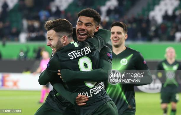 Wolfsburg's Brazilian defender Paulo Otavio celebrates after scoring the 1-0 lead with Wolfsburg's German midfielder Renato Steffen during the Europa...