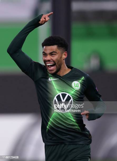 Wolfsburg's Brazilian defender Paulo Otavio celebrates after scoring the 1-0 lead during the Europa League group I football match between VFL...