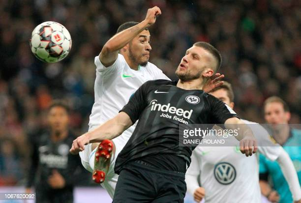 Wolfsburg's Brazilian defender William and Frankfurt's Croatian midfielder Ante Rebic vie for the ball during the German first division Bundesliga...