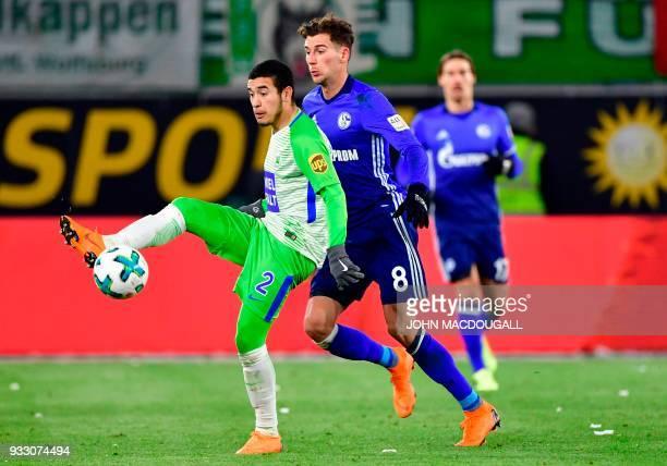 Wolfsburg's Brazilian defender William and Schalke's German midfielder Leon Goretzka vie for the ball during the German First division Bundesliga...