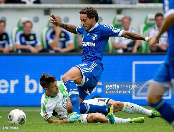 Wolfsburg's Brazilian midfielder Diego and Schalke's US midfielder Jermaine Jones vie for the ball during the German first division Bundesliga...