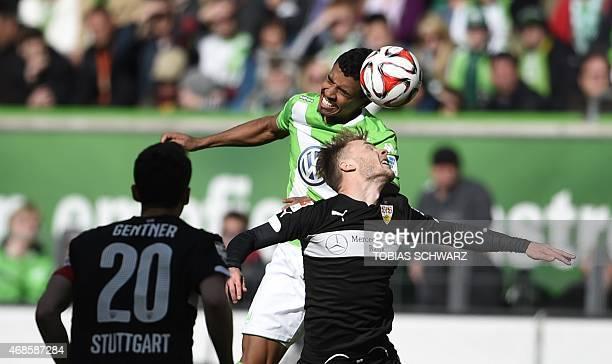 Wolfsburg's Brazilian midfielder Luiz Gustavo and Stuttgart's Rumanian midfielder Alexandru Maxim vie for the ball during the German first division...