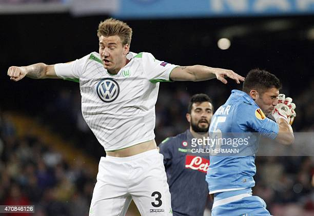 Wolfsburg's Danish forward from Denamrk Nicklas Bendtner fights for the ball with Napoli's Argentinian goalkeeper Mariano Andujar during the UEFA...