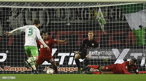 Wolfsburg's Danish forward Nicklas Bendtner shoots to score past Leverkusen's goalkeeper Bernd Leno during the German first division Bundesliga...