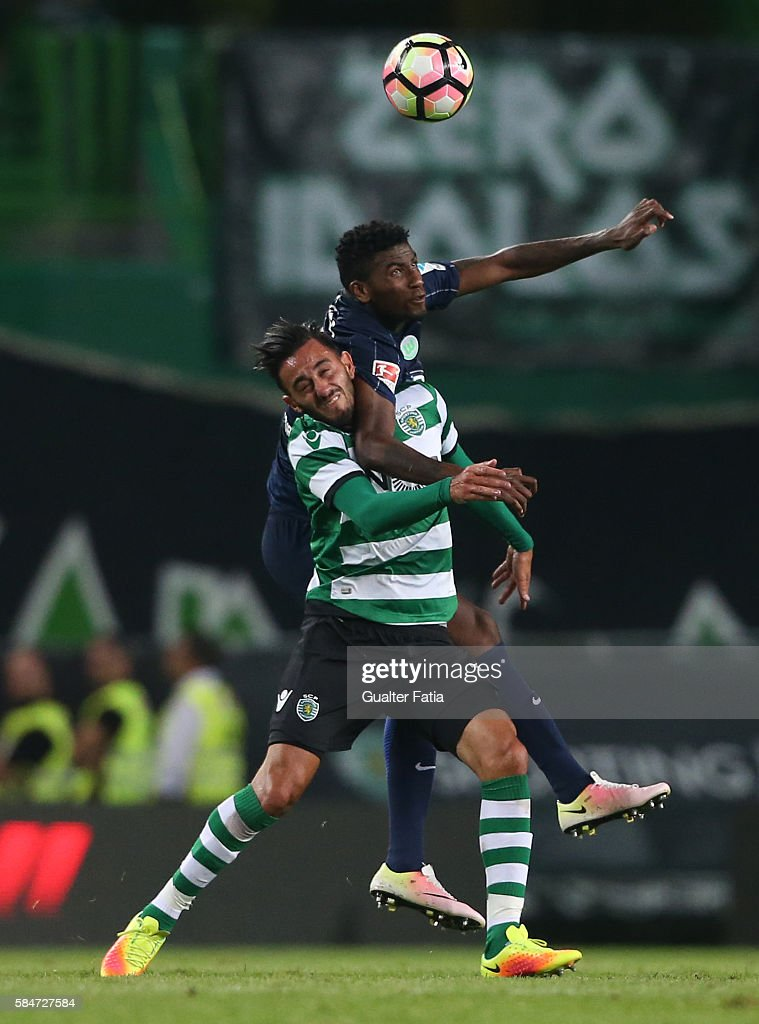 Wolfsburg's defender Carlos Ascues with Sporting CP's midfielder Alberto Aquilani from Italy in action during the Pre Season Friendly match between Sporting CP and Wolfsburg at Estadio Jose Alvalade on July 30, 2016 in Lisbon, Portugal.