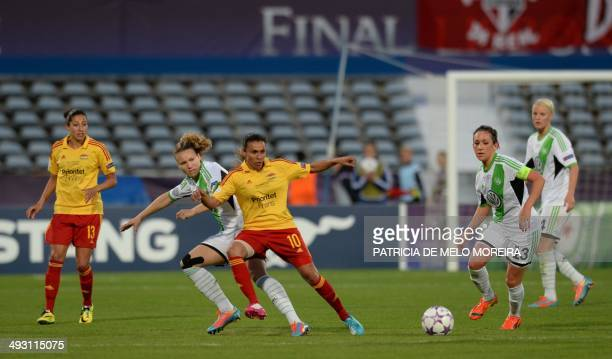 Wolfsburg's defender Josephine Henning vies with Tyreso's Brazilian forward Marta during the UEFA Women's Champions League final football match...
