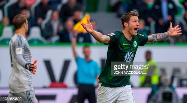 Wolfsburg's Dutch forward Wout Weghorst reacts after being fouled during the German First division Bundesliga football match between VfL Wolfsburg...