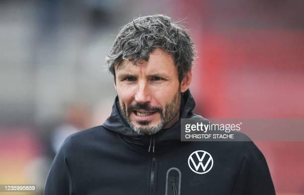Wolfsburg's Dutch head coach Mark van Bommel arrives for an interview prior the German first division Bundesliga match between Union Berlin and VfL...
