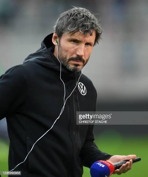 Wolfsburg's Dutch head coach Mark van Bommel prepares for an interview prior the German first division Bundesliga match between Union Berlin and VfL...