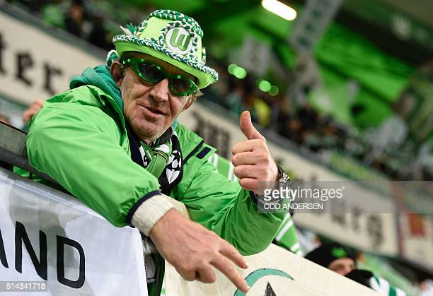 Wolfsburg's fan is pictured prior the second-leg round of 16 UEFA Champions league football match between VfL Wolfsburg and KAA Gent at the...
