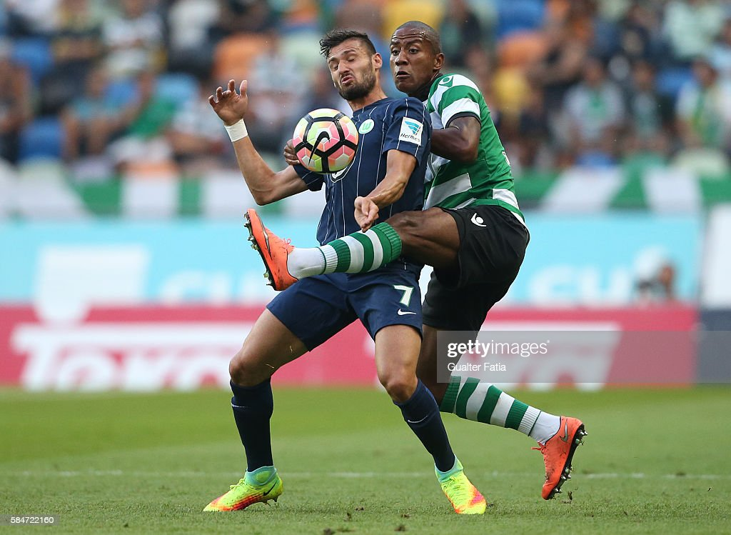 Wolfsburg's forward Daniel Caligiuri with Sporting CP's defender Marvin Zeegelaar from Holland in action during the Pre Season Friendly match between Sporting CP and Wolfsburg at Estadio Jose Alvalade on July 30, 2016 in Lisbon, Portugal.