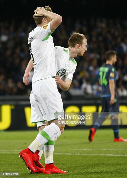 Wolfsburg's forward from Denmark Nicklas Bendtner is encouraged by teammate Wolfsburg's midfielder from Germany Maximilian Arnold after failing a...