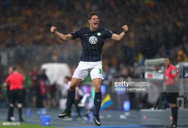 Wolfsburg's forward Mario Gomez celebrates after German Bundesliga relegation second leg football match between Eintracht Braunschweig and Vfl...