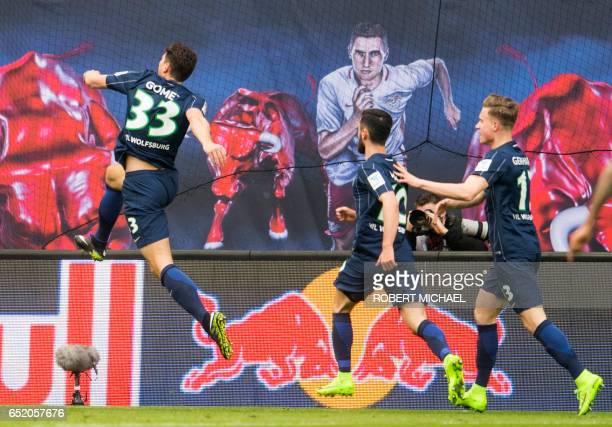 Wolfsburg's forward Mario Gomez celebrates after soring the first goal during the German First division Bundesliga football match of RB Leipzig vs...