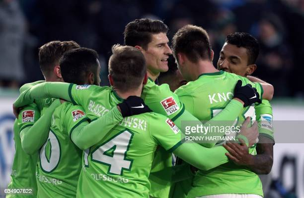 Wolfsburg's forward Mario Gomez of Wolfsburg and team mates celebrate their team'S second goal during the German First division Bundesliga football...