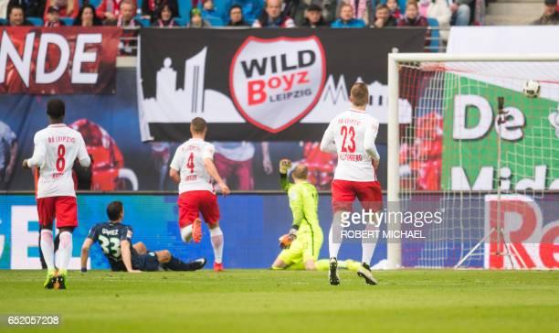 Wolfsburg's forward Mario Gomez scores during the German First division Bundesliga football match of RB Leipzig vs VfL Wolfsburg in Leipzig eastern...