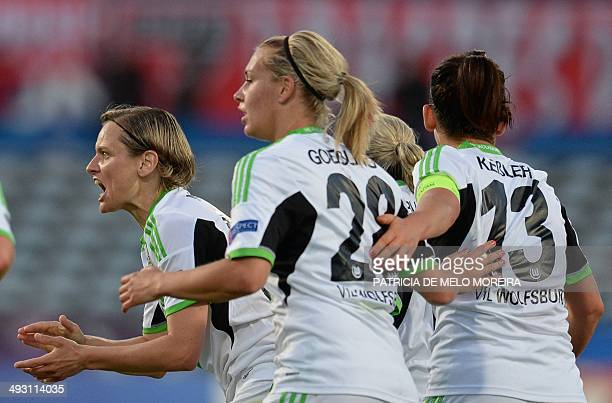 Wolfsburg's forward Martina Mueller celebrates with teammates after scoring during the UEFA Women's Champions League final football match Tyreso FF...
