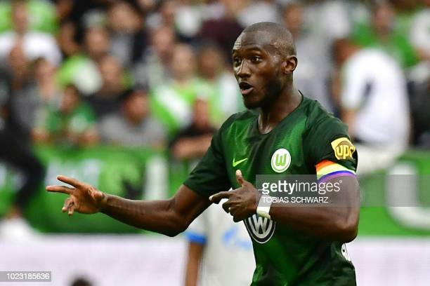 Wolfsburg's French midfielder and team captain Josuha Guilavogui reacts during the German first division Bundesliga football match VfL Wolfsburg v FC...