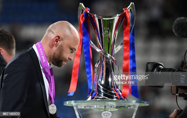 Wolfsburg's German coach Stephan Lerch walks past the trophy after being defeated at the end of the UEFA Women's Champions League final football...