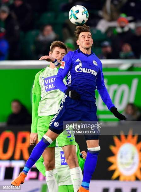 Wolfsburg's German defender Robin Knoche and Schalke's German midfielder Leon Goretzka vie for the ball during the German First division Bundesliga...