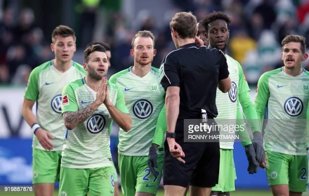 Wolfsburg's German defender Robin Knoche Swiss midfielder Renato Steffen German midfielder Maximilian Arnold Belgian forward Divock Origi and German...