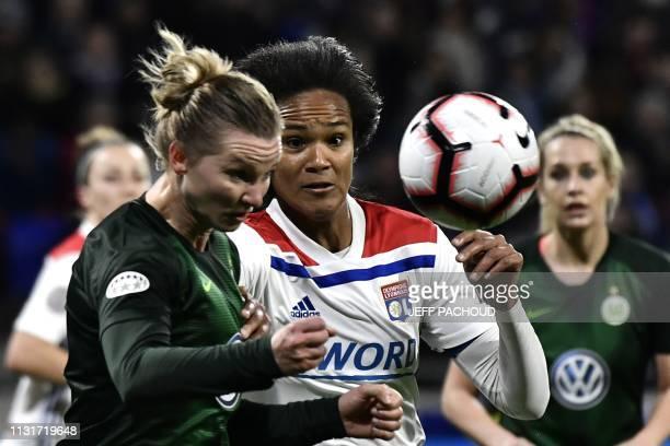 Wolfsburg's German forward Alexandra Popp vies with Lyon's French defender Wendie Renard during the UEFA women's Champions League quarterfinal...